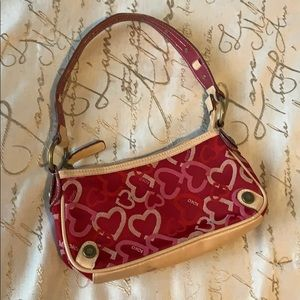 Red, cream, and pink xoxo clutch purse 😍😍😍